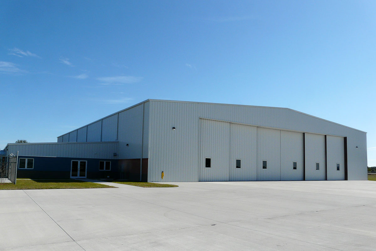 Baer Air Charter's 24,500-sq-ft metal building hangar at Melbourne International Airport features massive 28-ft-tall doors.