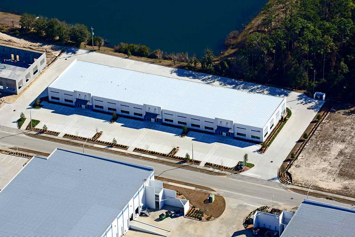 Aerial of a single-story, long bay metal building system with 45-ft bays in the rear at Port Jax Trade Center in Florida.