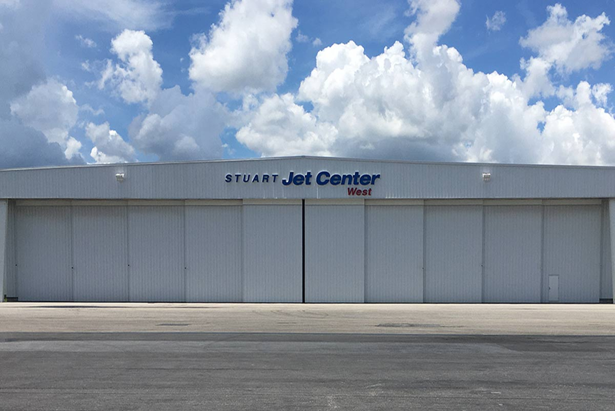 This 200-ft clear span hangar is one of several metal building systems housing airplanes at Stuart Jet Center in Florida.
