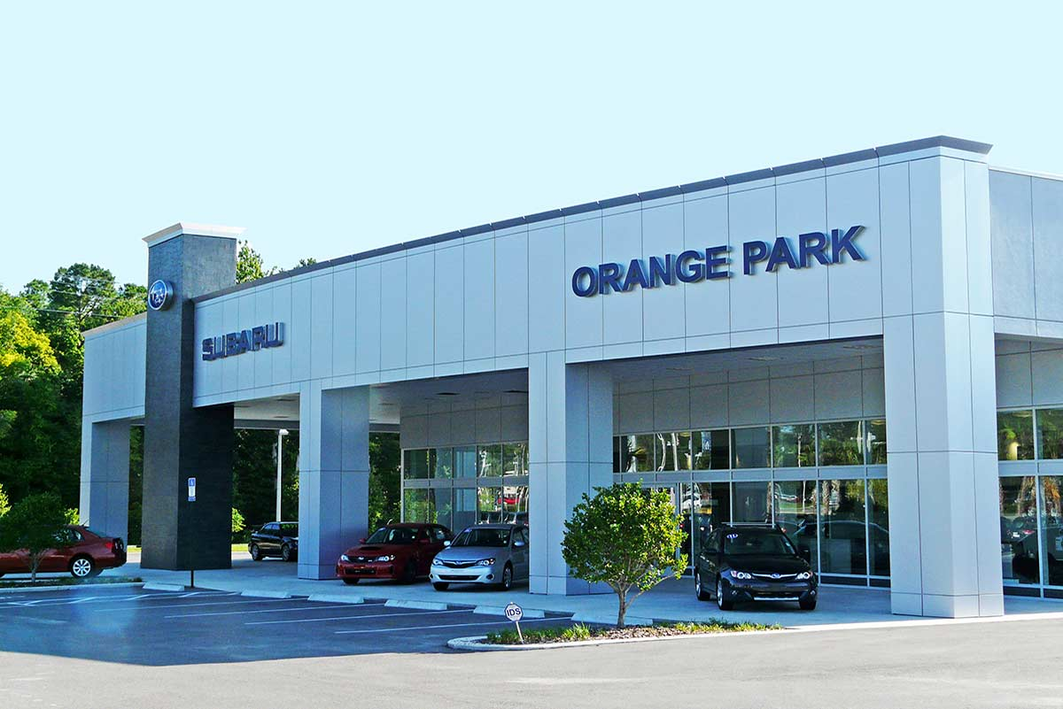 Hanania Subaru's modern metal building design features wall of windows displaying new and used cars in Jacksonville, Florida.