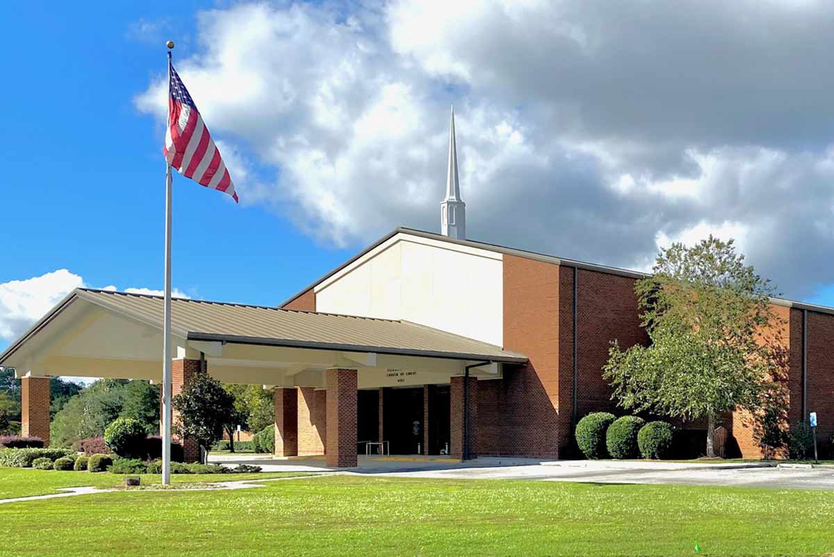 This church is a metal building clad in brick and includes a drive-thru portico for parishioners to use on rainy days.