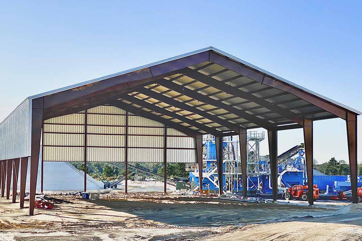 This clear span rigid frame metal building accommodates a sand processing operation.