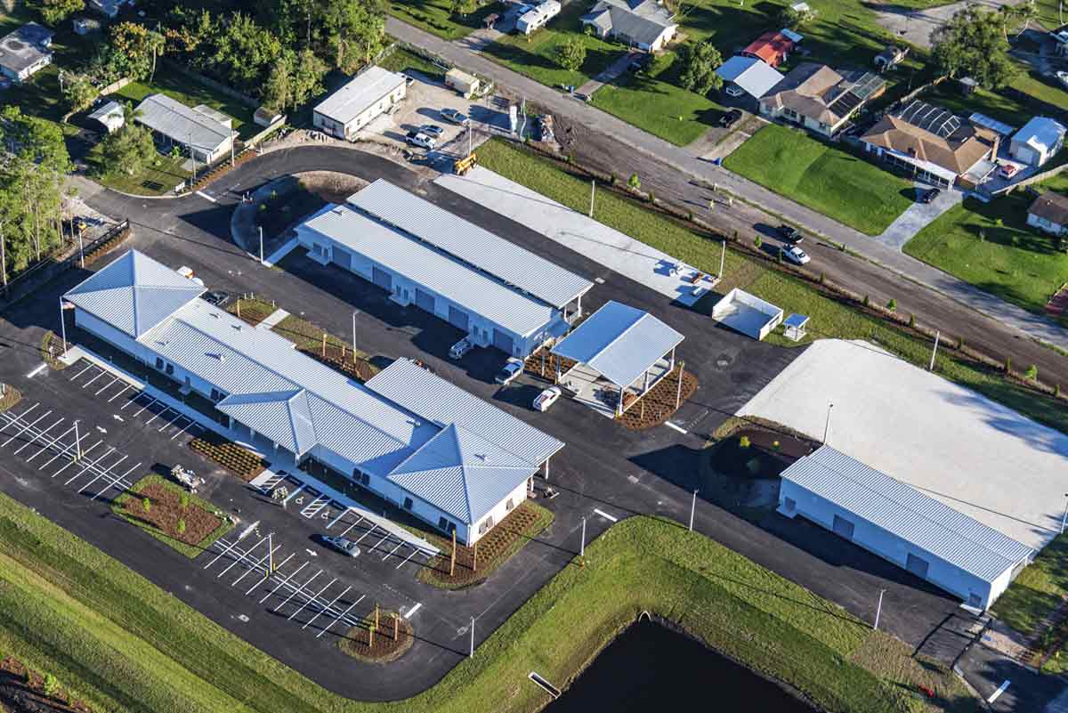 Volusia County Public Works features metal buildings for operations, vehicle storage, ancillary wash rack and ancillary asphalt tack storage.